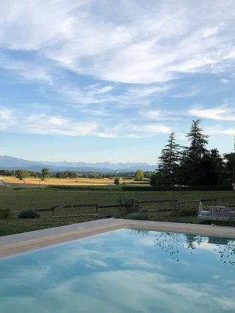Gaudiès, France: View across the pool to the Pyrenees