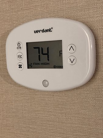 """Thermostat set at 68, what I usually set my rooms at for working and sleeping.  It was on """"cool"""" and kept shutting off so the room would heat up.  74 was as low as it would go.  Ceiling panel was corroded."""