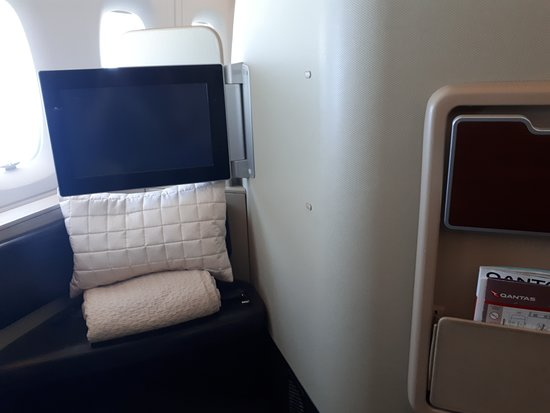 Qantas: Foot area of seat showing ottoman and entertainment monitor
