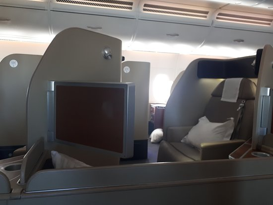 Qantas: Looking back to adjacent seat in middle of aircraft.