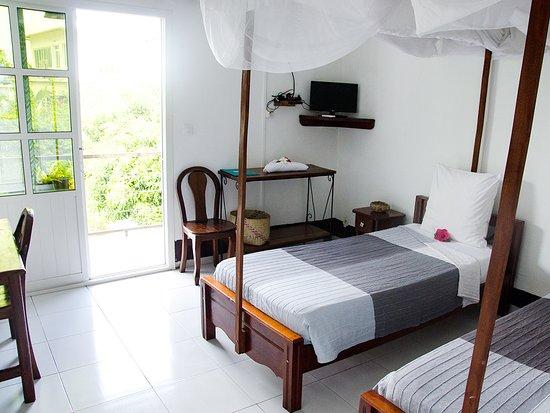 Chambre lits jumeaux vue jardin