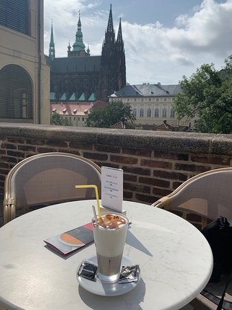 ice coffee and Prague Castle & Church behind