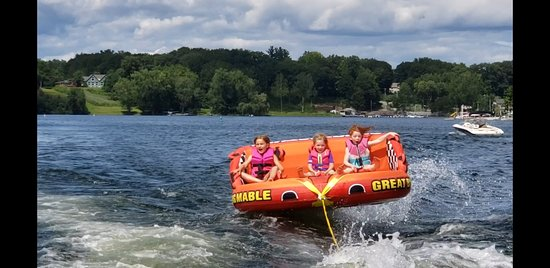 "First Mate Lindsey innthe middle showing her cousins how to hold on as we cross a wake.  These 6, 7, and 8 year old girls were yelling ""faster faster..."""