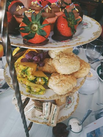 High Tea Here For You  Thursdays - Sunday 11am, 11:30am, 1:30pm, 2:00pm  $21.44 (includes tax & gratuity.)  3 Tiered Caddy   4 assorted sandwiches on the bottom layer  Scones w/ Devonshire Cream &  Jam, and Fresh Fruit centered  Tea Cake and Chocolate covered Strawberry on the top layer  Your pot of tea flows endlessly.