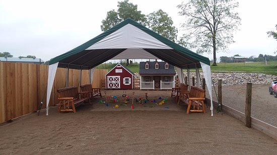 New Paris, OH: At Happy Rancher's Corral the children can enjoy a gigantic sandbox with play houses and toys. Endless hours of fun. Added seating for parents who want to sit and relax while children are at play!