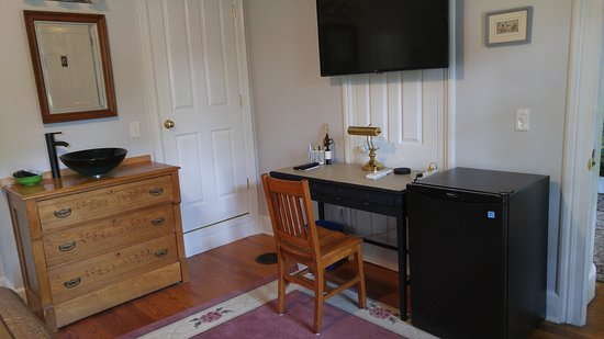 All rooms have a refrigerator, large TV, chest of drawers, and a desk.