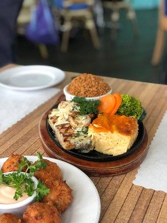 Mahi Mahi Sizzling Platter with peas n rice, bahamian baked macaroni and vegetables