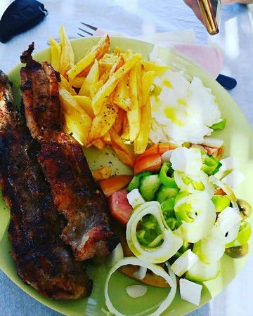Pork meat, french fries and salad