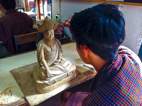 Тхимпху, Бутан: Student learning sculpturing at  traditional school