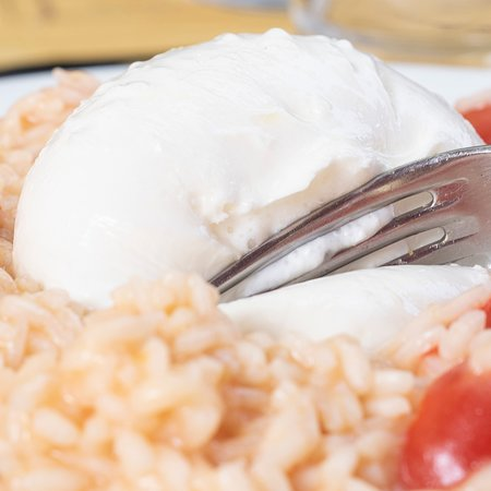 Verrua Savoia, Italië: Burrata su risotto ai pomodorini.
