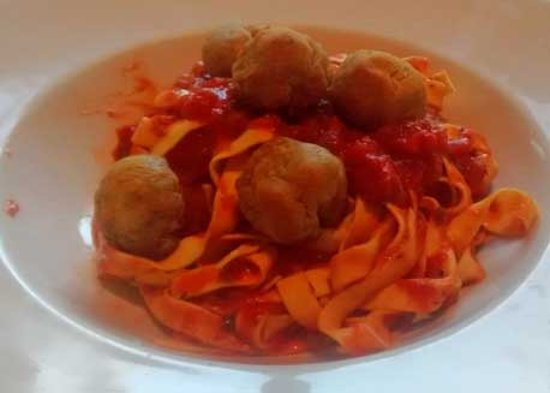 Eastham, UK: Falafel 'meatballs' on a bed of tagiatelle with red pepper ragu.