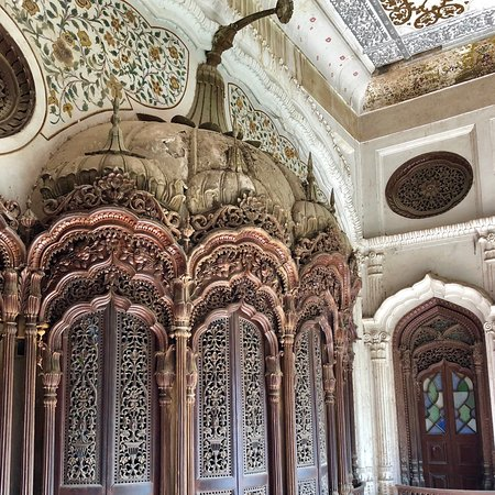Umar Hayat Palace Library/ Gulzar Manzil Umer Hayat Mahal, and alternatively known as Gulzar Manzil, is an early 20th-century wooden haveli mansion in Chiniot, Pakistan. Construction started in 1923, and was completed by 1935. The mansion, originally 5-storeys tall, was built by Sheikh Omar Hayat - a Chinioti businessman who made his fortune in Calcutta. The edifice is an outstanding display  of Chiniot's local woodworking and  a great amalgamation of various styles of architecture and design.