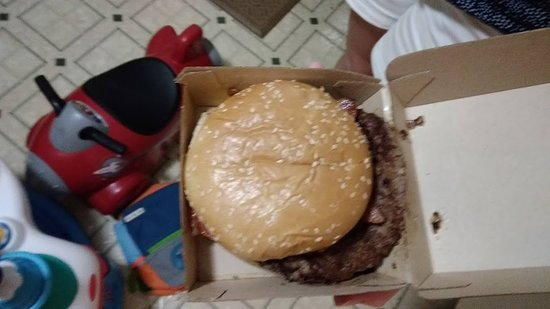 They can not even be bothered to put a burger on a bun straight.