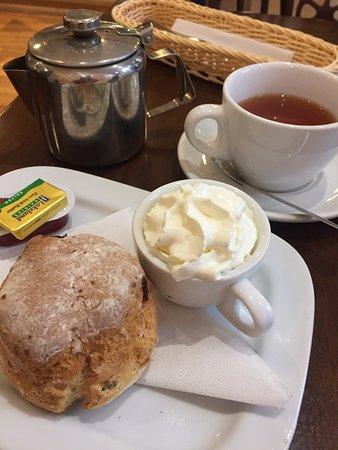 Fruit scone and tea