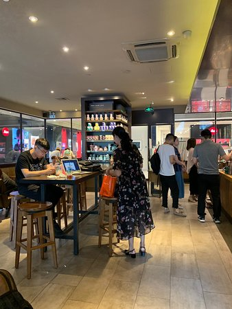 Starbucks (Yi JiaDao): Pleasant place to order a delicious drink and dessert. The staff is very pleasant and responsive. The place is modern and clean. Various merchandise such as drink cups, tea packages and other trinkets are available for purchase.