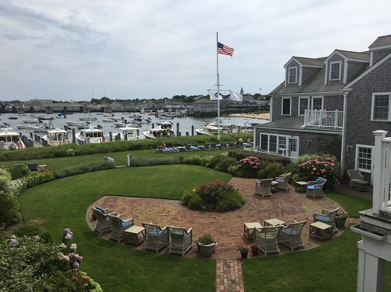View of courtyard and Nantucket Harbor from hotel's main building guest room.