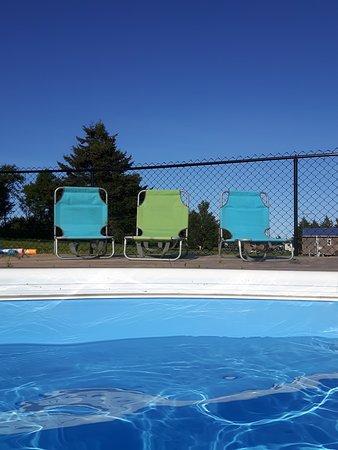 Sweet seats poolside.