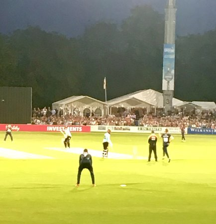 Bowling from the Pavilion end, under lights.