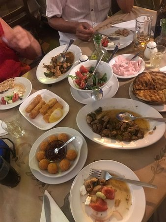 Sirtaki: Before and after👍 Fried pork, Saganaki, cheese balls, Greek salad, fried chicken, Taramosalata and delicious pita. Wonderful staff. Family style from kitchen to waiter, best place I Ixia!