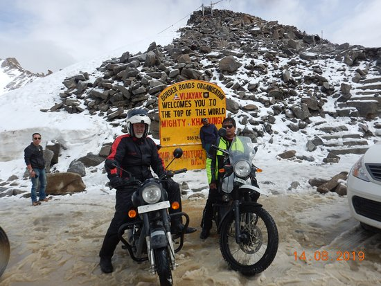 Manali Ladakh Motorcycle Expedition: On the World's highest pass. Myself on the left & our tour leader, Suraj on the right.