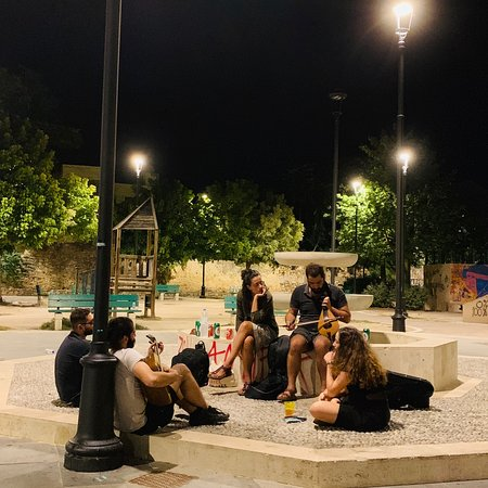Graffiti and youth playing traditional music