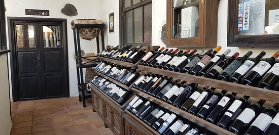 All very expensive (empty!) wine bottles suggest there is better, than what you get if you're not choosing. So, ask explicitly for a better wine, then you wount be disappointed as I was.