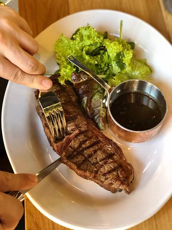 White Bear: Whether you like your meat well done, medium rare, our 28 day dry-aged Aberdeen Angus steaks are grilled to perfection on our theatrical charcoal garden grill