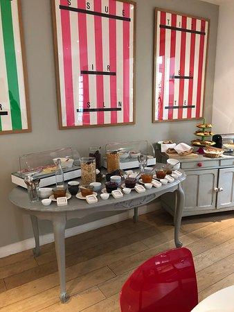 Delightful breakfast!  Croissants, bagettes, ham, cheese, eggs, yogurt, cake, juices and coffee.  Delish!