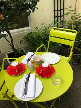 Breakfast in the courtyard of Hotel Arvor.