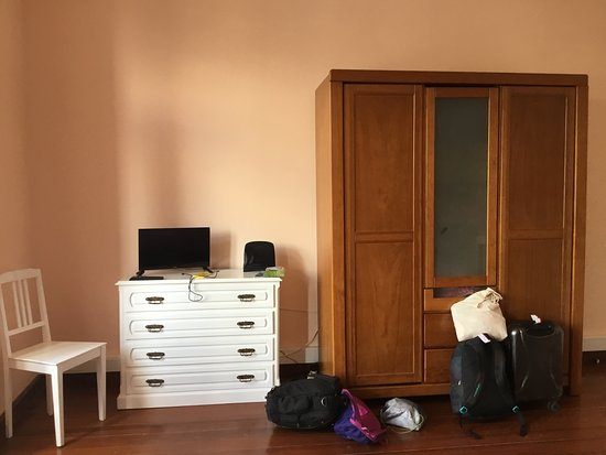 Novelao House: This Cabinet will hold 20 suitcases, not two like us.