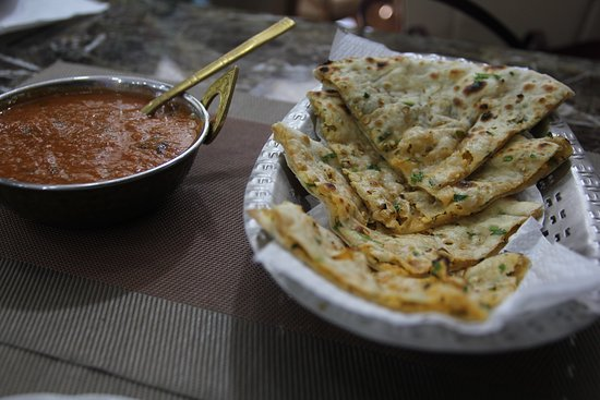 Bollywood Restaurant BN: Our famous dish; Butter Chicken Masala and Garlic Naan, made with love, of course!