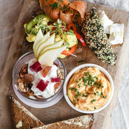 Scandi Board with scrambled eggs + cured salmon + avocado + danish feta + preserved vegetables + rye + Skyr granola
