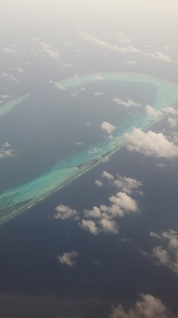Maldivler: While flight was over Maldives Islands.