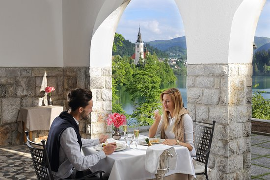 Restaurant Vila Bled and its magnificent terrace with a view across Lake Bled and the island.