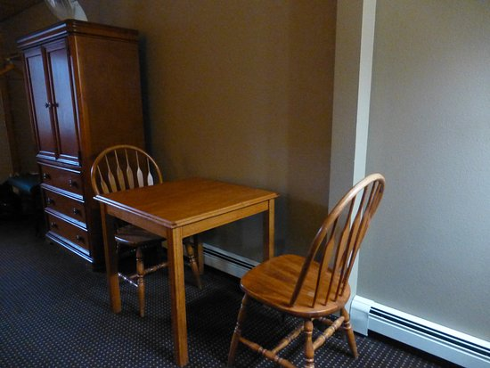 Denali Park Village: table and chairs (cabinet door is a hazard)