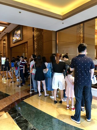 "queue for breakfast at hotel restaurant - ""Feast"""