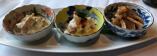Three Waves Tuna:  Tuna Goma-ae: cubic tuna sashimi, sesame mayo vinaigrette Tuna Sumiso-ae: medium rare tuna, egg yolk miso vinaigrette Tuna Tataki: seared tuna, yuzu pepper soy, grated daikon