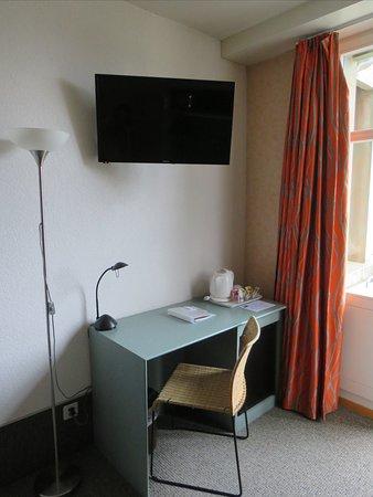 Desk with mini fridge & hotpot to right.
