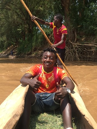 Over Omo river with local canon boat.