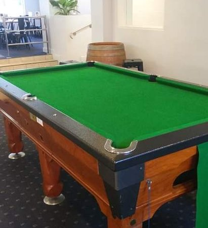 Enjoy a game on the pool table