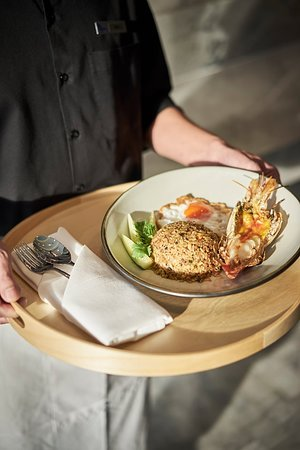 "Come and try our Chef's Signature Dish ""Khao Pad Man Goong"" served with grilled fresh giant river prawn.  📞 RSVN : 02-119-2188"