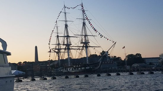 Boston Green Cruises: USS Cobstitution with Bunker Hill Monument in background