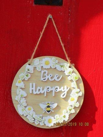 A little bon mot hanging on an almshouse door