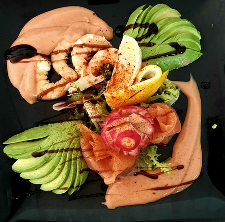 Carob Bar: Avocado Salad with Fresh Prawns & Smoked Salmon finished with a Pink Brandy Sauce from the evolving Starter Menu available all day.