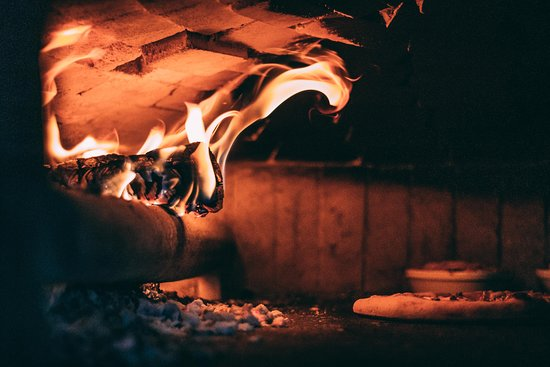 All our pizzas are baked in wood fired oven