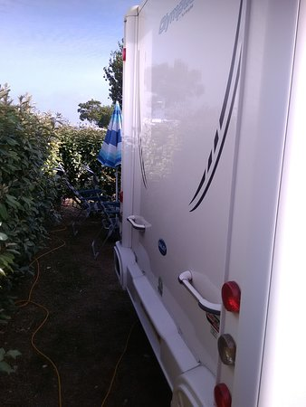 Gap between the rear of our caravan and the hedge.