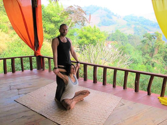 Crawley, UK: Marek Gabor, founder of Jungle Healing, carrying out a full body Thai Yoga Massage.