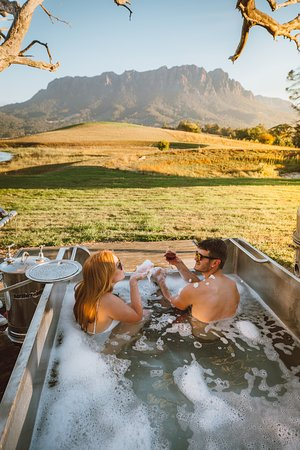 Bath in our unique outdoor milk vat with stunning mountain views.