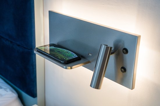 Bedside wireless charging pads in every room