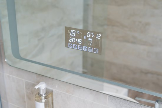 Bluetooth enabled mirrors in the bathrooms